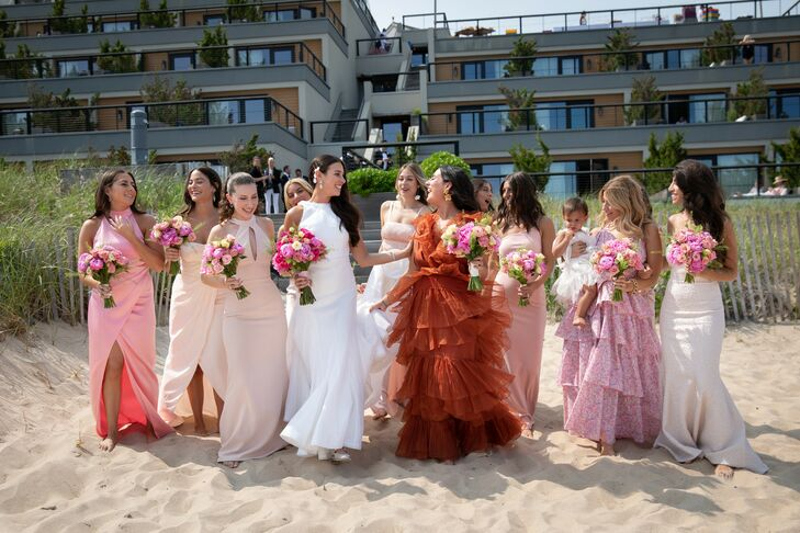 Modern Bridesmaids with Mismatched Dresses and Pink Bouquets