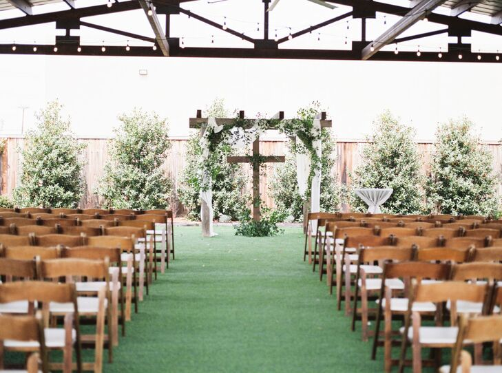 Wood Wedding Arch with Greenery, White Draping and Wood Cross