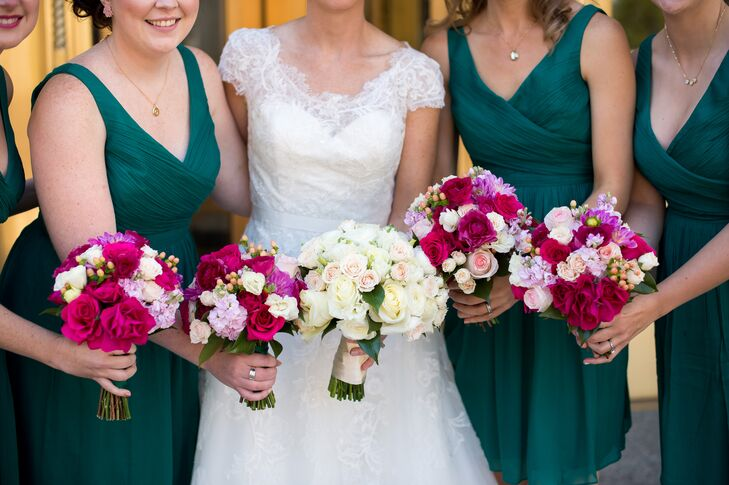 Contrasting Katherine's neutral arrangement, the bridesmaid bouquets featured hot and blush pink blooms.