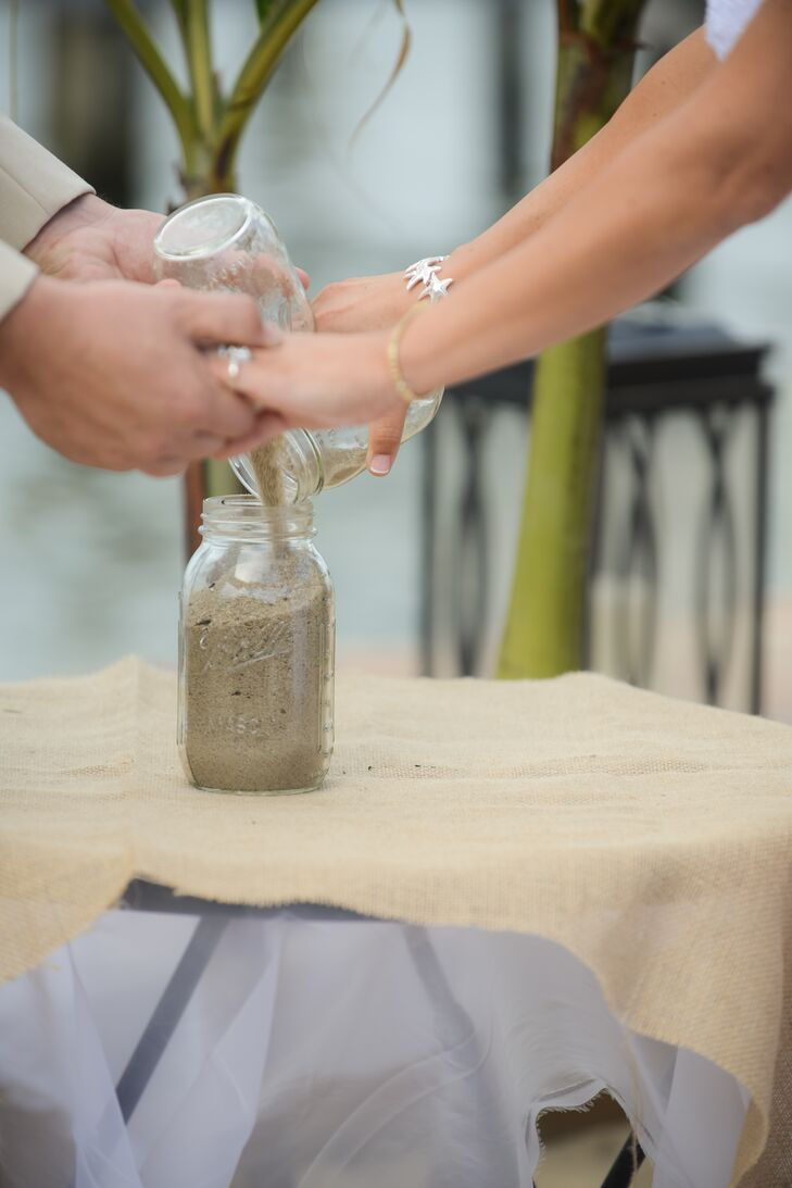 During their beach ceremony, Caitlin and Tom mixed two jars of sands to symbolize their union.