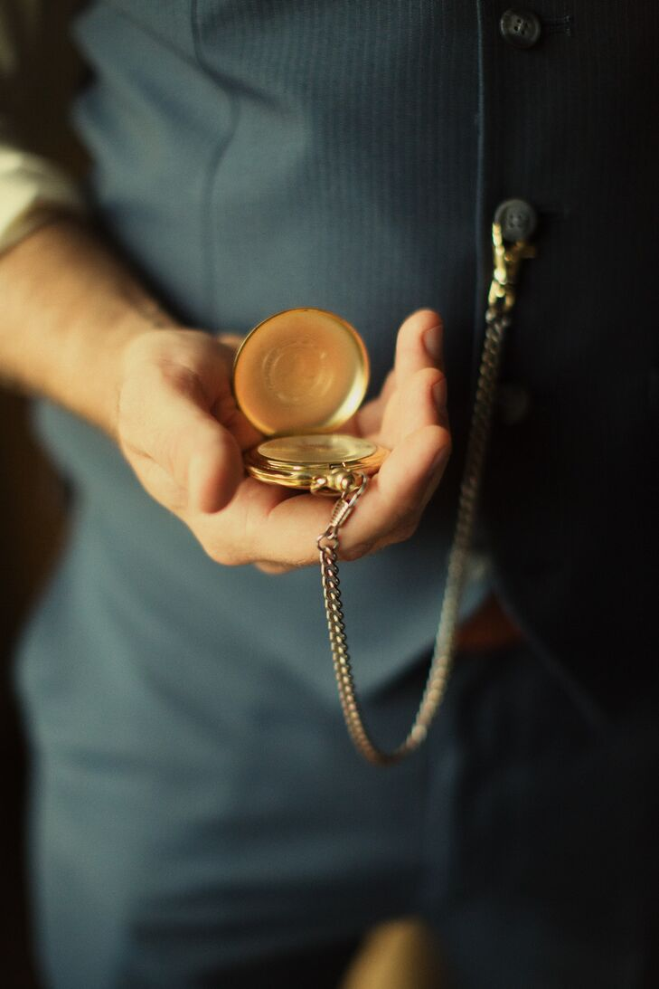 Since each groomsmen took on his own English gentleman-inspired look, they were free to choose all accessories. Two of Owen's attendants even wore chained pocket watches to match the theme.