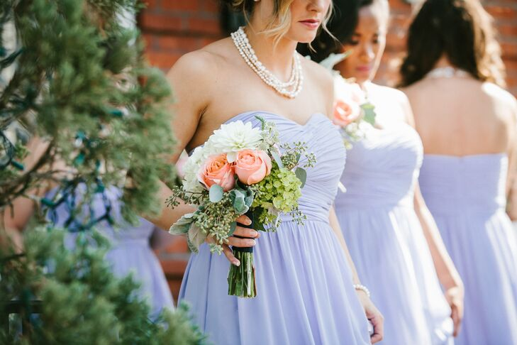 The bridesmaids wore strands of pearl jewelry and carried bouquets of pink garden roses, white dahlias, viburnum and dusty miller.