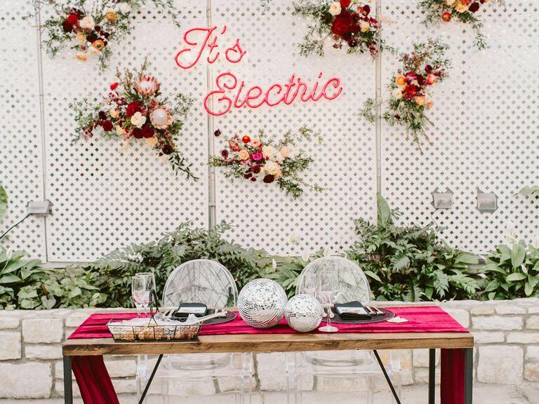 spring wedding centerpieces disco balls on colorful linens