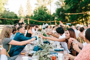 Whimsical Outdoor Seated Meal with String Lights