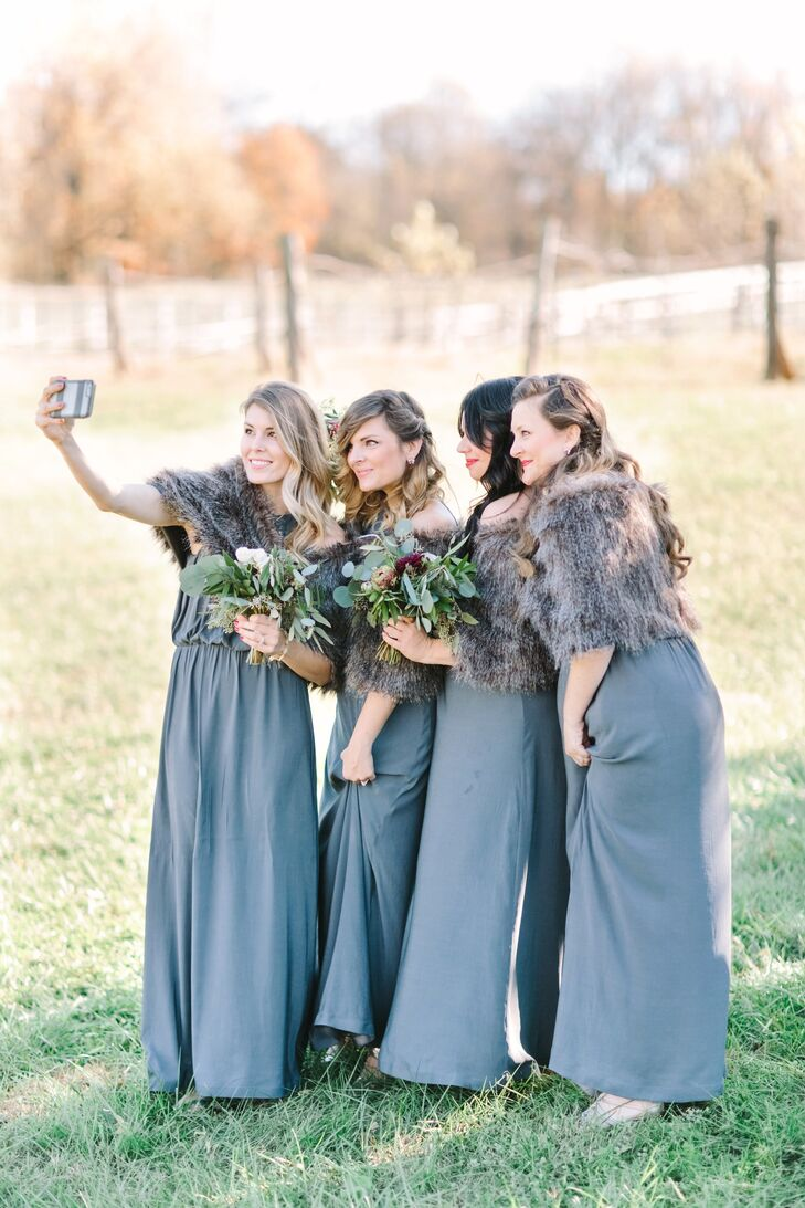 """My bridesmaids were gorgeous,"" Lydia says. Their long, gray dresses came from H&M for just $35. Their custom furs were a gift from Lydia and turned out to be the perfect accessory for an autumn day."