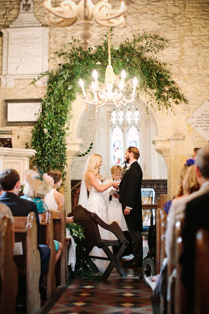 Church Ceremony with Chandelier and Greenery