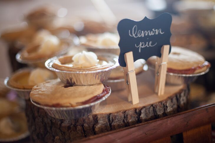 Instead of ending dinner with the traditional slice of wedding cake, Jennifer and Whitney decided to choose a dessert choice that perfectly played up their wedding's picnic theme. Following a dinner of summer favorites like fried chicken and potato salad, the couple served up an assortment of mini fruit pies. rn