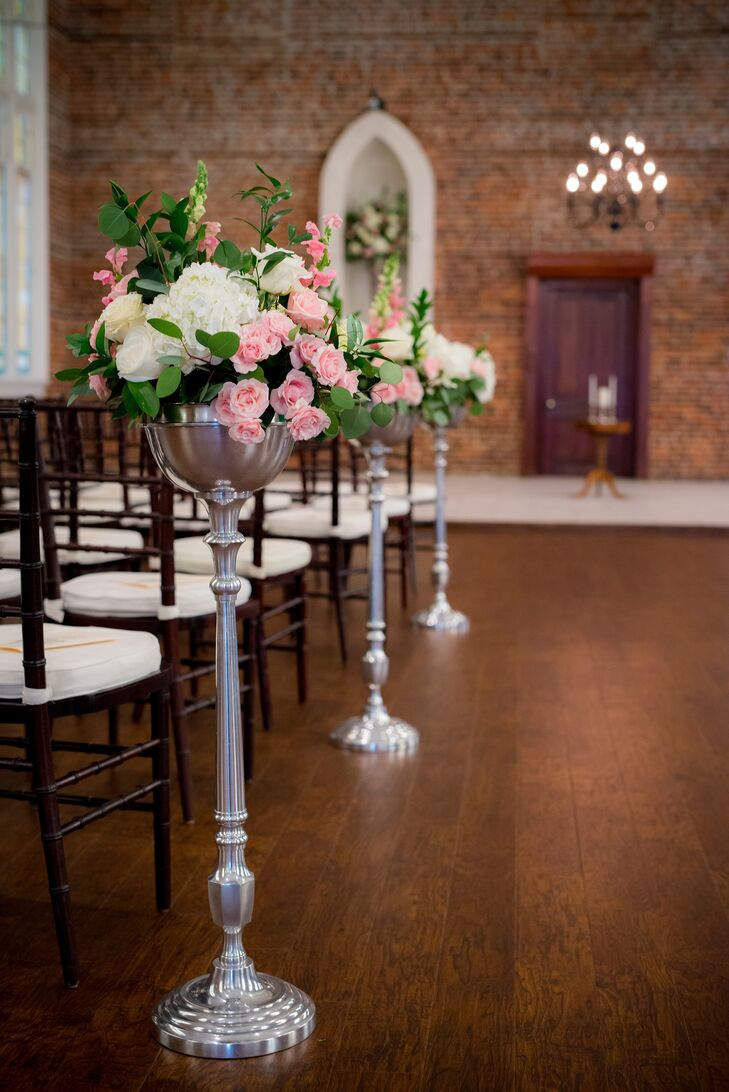 Elizabeth and Tim (with the help of their family and friends) created all the lush floral arrangements for the wedding. The aisle was lined with towering silver urns filled with pink roses, white peonies, pink snap dragons and green eucalyptus leaves.