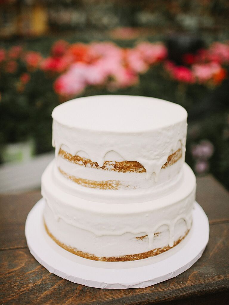 Naked wedding cake with a frosted drip design
