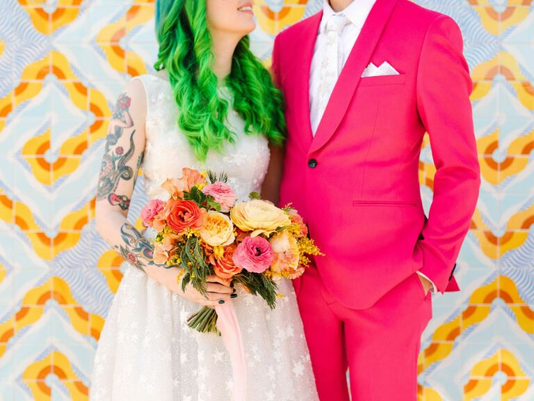 Bride and groom at colorful wedding