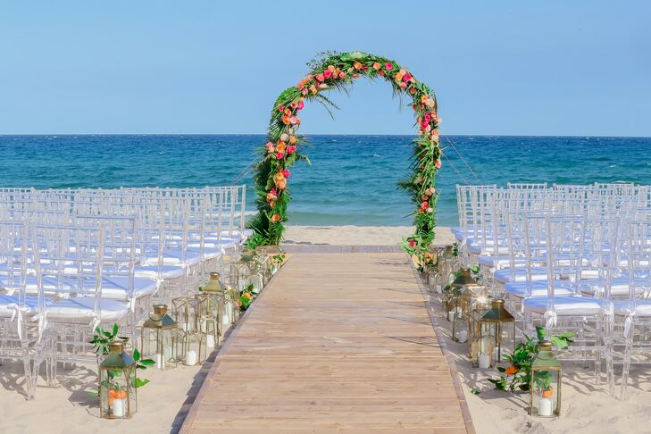 Beach Ceremony Site with Tropical Wedding Arch, Lanterns and White Chiavari Chairs