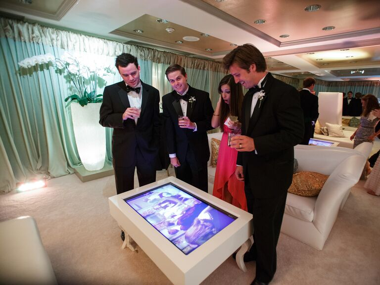 Wedding reception lounge area with video tables