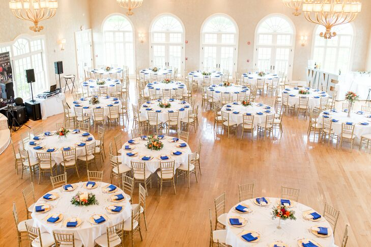 """We kept the decor pretty simple because Morais is already so beautiful,"" Jasmine says of Morais Vineyards & Winery in Bealeton, Virginia. The elegant ballroom was gussied up with white and blue linens and gold chiavari chairs."