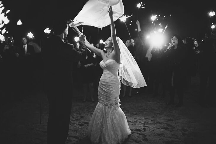 """The night ended with a s'mores table and an outdoor fire pit; on the way there, guests were handed sparklers and the bridal party was given Japanese wish lanterns. """"We all bid farewell by lighting up the night sky,"""" recounts Elaine."""