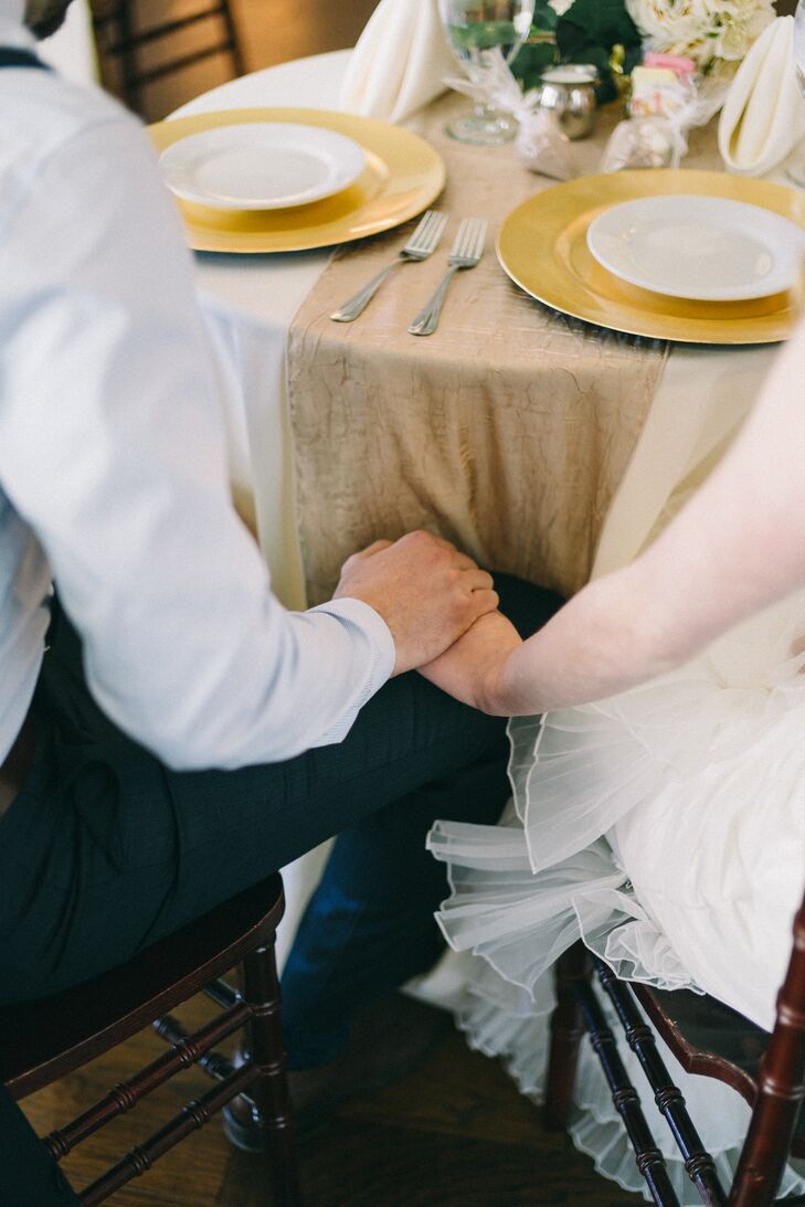 Newlyweds Holding Hands Under the Table