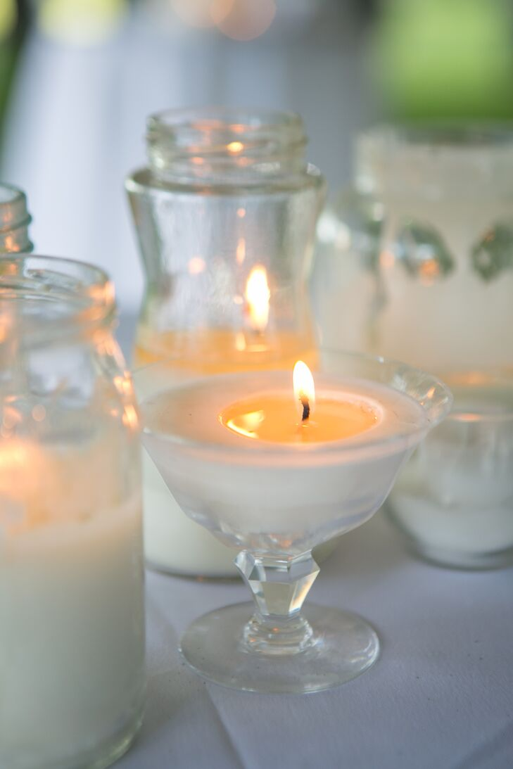 """""""My decor was about 500 handmade—by myself and my bridesmaids—soy wax candles made in recycled jars for the outside tables,"""" Kate says."""