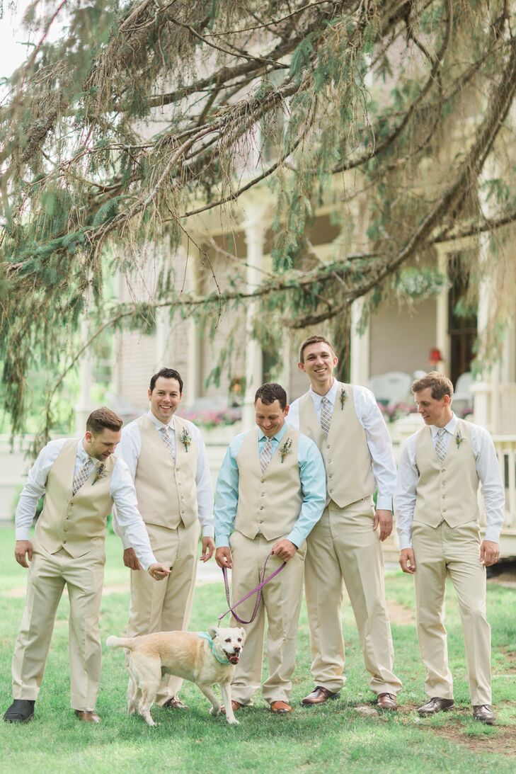 Ben and his groomsmen wore khaki vests and trousers and light blue shirts. Ben stood out in a deeper blue shirt. The men pinned lavender boutonnieres to their vests to complete the look.