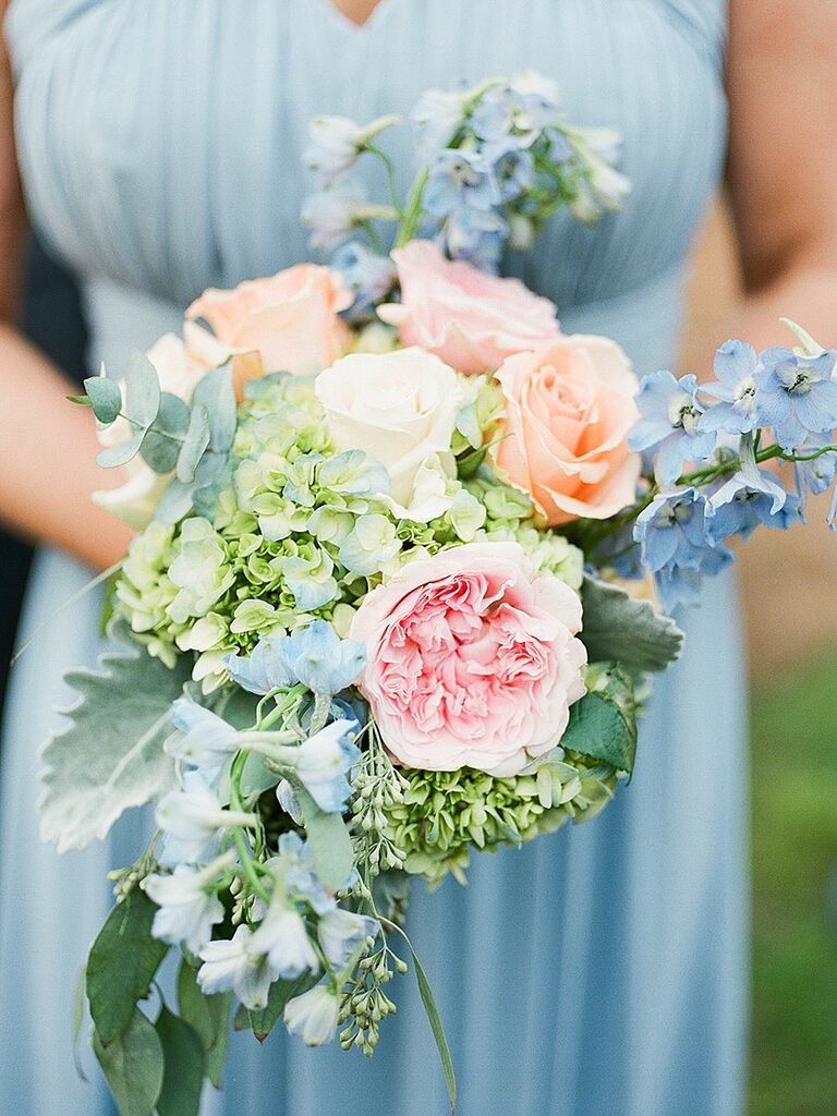 Blue and peach bridesmaid bouquet made with Garden roses, roses, viburnum, hydrangeas and delphinium​