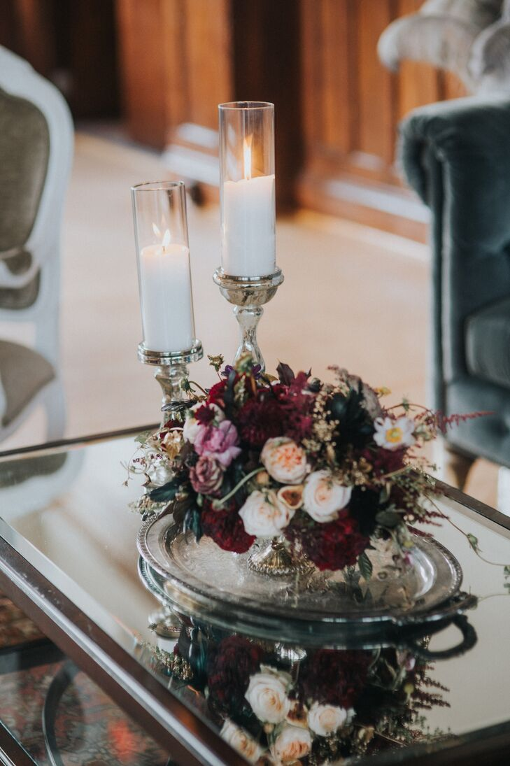 Flower arrangements incorporated a mix of fall-colored blooms and vintage vases.