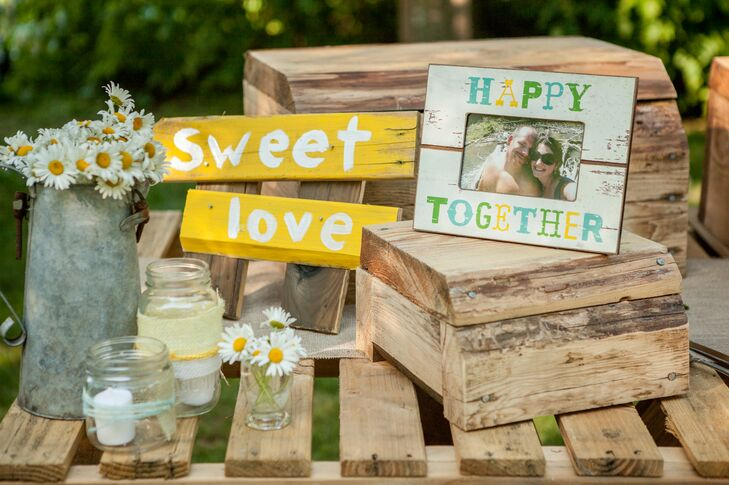 """I was inspired first by the idea of using wooden pallets for all the furniture and tables,"" says Jessica. ""Michael built the tables our food tables, the bar, the arbor, croquet stand, the guest sign in, a lemonade stand, and even the cake table. I sketched everything I pictured it in my mind and he built it!"""
