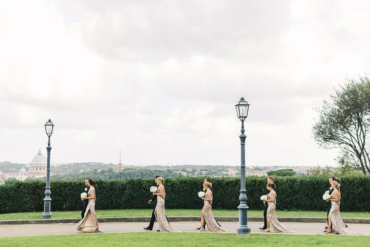 """To complement the wedding's white and gold palette and glamorous theme, Silje had her three maids of honor and three bridesmaids don floor-length sequin gowns in a luxe gold hue. """"I loved the open back on the dresses, and in the front, we made some adjustments to make the dresses unique for our wedding,"""" Silje says. """"I wanted the girls to feel pretty and fabulous on the wedding day, like they deserve."""""""