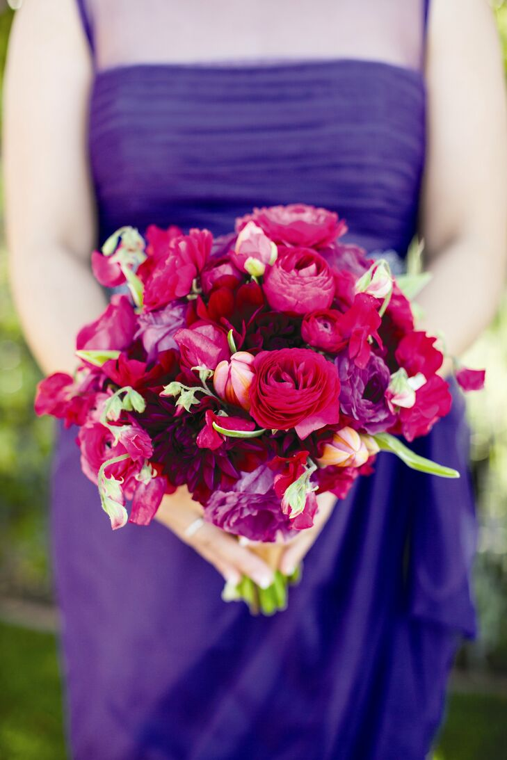 Each bridesmaid carried a jewel-tone bouquet that complemented her dress. A variety of blooms made up the bouquets, including roses, tulips, sweet peas and dahlias.