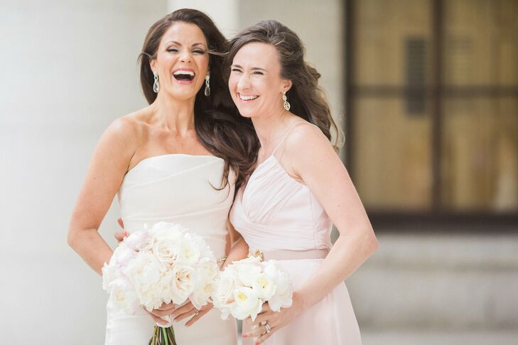 The bridal bouquet was stunning in a soft, romantic palette of fluffy peonies and fragrant garden roses in shades of barely blush, pink and ivory to create a dreamy compact bouquet. Bridesmaids donned similar shades of blush and rose.