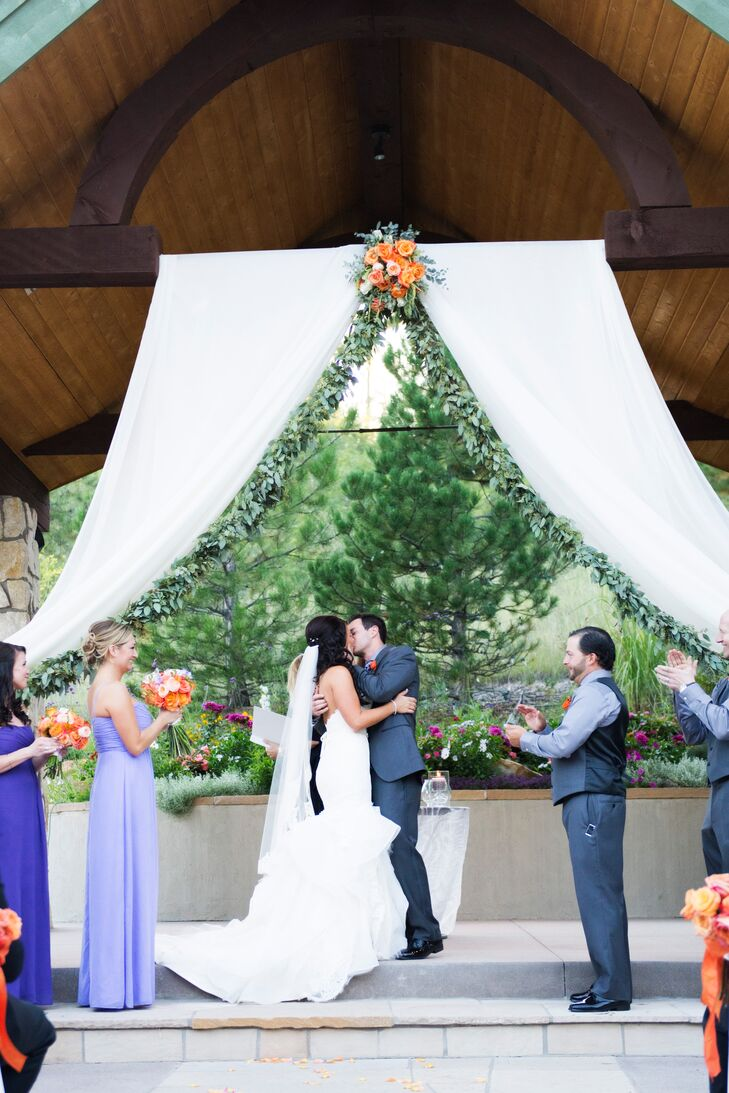 """""""I grew up Catholic and Josh grew up Jewish,"""" Cara says. """"So we chose to have a nondenominational wedding, but incorporated pieces of both backgrounds. We used both unity candles and stomping of the glasses."""""""