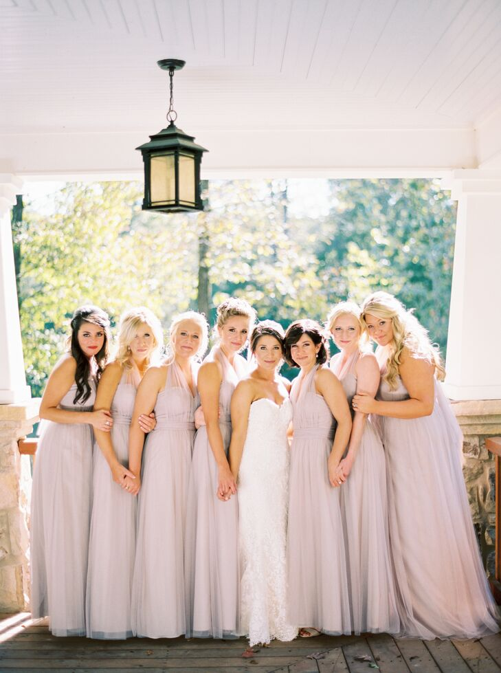 Ali's seven bridesmaids wore floor-length latte-colored dresses to complement her color scheme of pale pink, beige, gold and champagne.