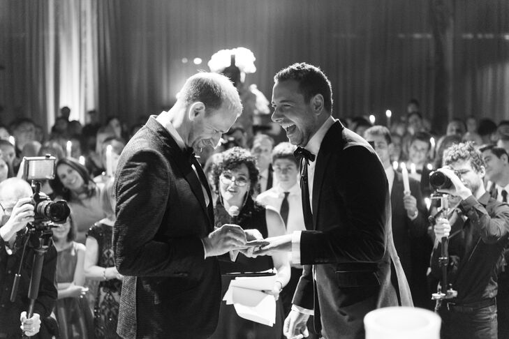 Guests held taper candles as the couple exchanged personalized vows on a stage in the center of the room. To honor Michael's Jewish heritage, the pair broke glasses and danced the hora. Then an Italian accordion player serenaded the crowd in an ode to Mike's family.