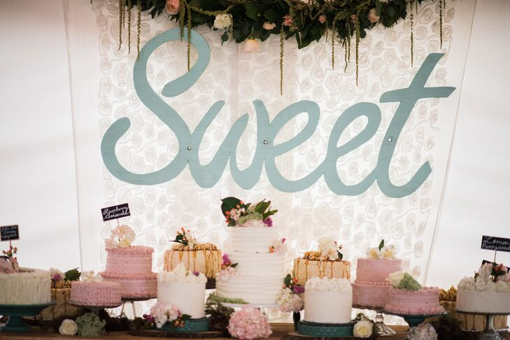 After dinner, the newlyweds treated their guests to an entire assortment of perfectly frosted wedding cakes. Flavors like lemon poppy seed and raspberry cheesecake put a sweet finish on the family-style meal.