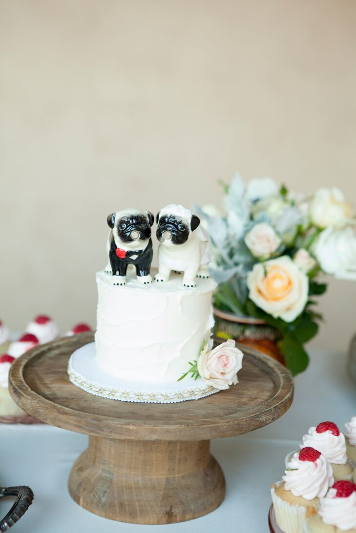 The Wedding Cake Topped With Pug Figurines