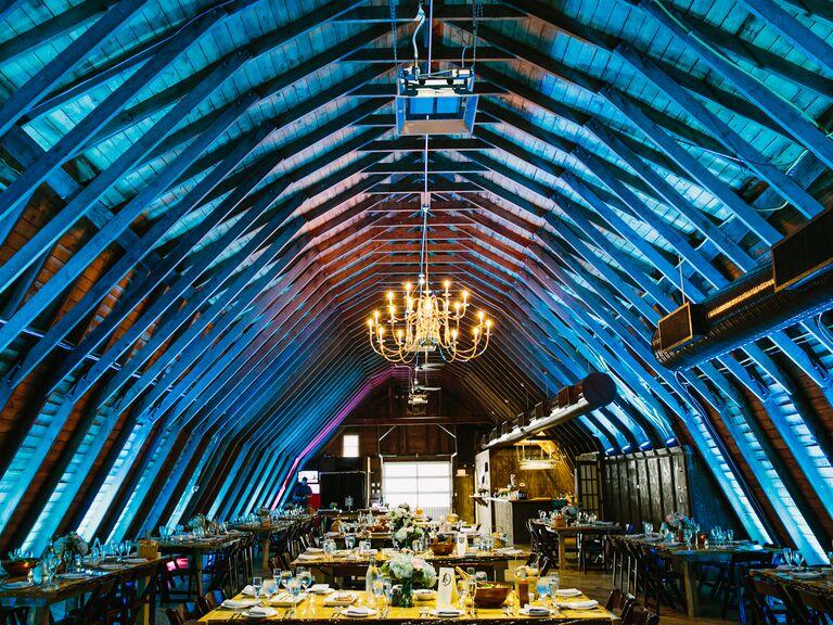 Barn wedding with blue uplighting