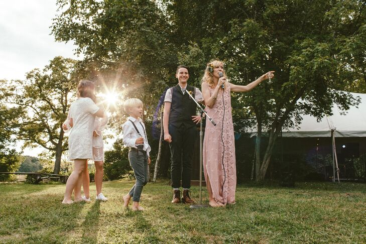 "After the ceremony, ""We just lounged around in this great big field, danced, had a bonfire, ate food from the food truck, climbed the treehouse and played,"" Ariana says. ""It was perfect."""