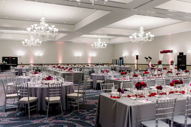 Modern Ballroom Reception with Gray Linens and Red Centerpieces