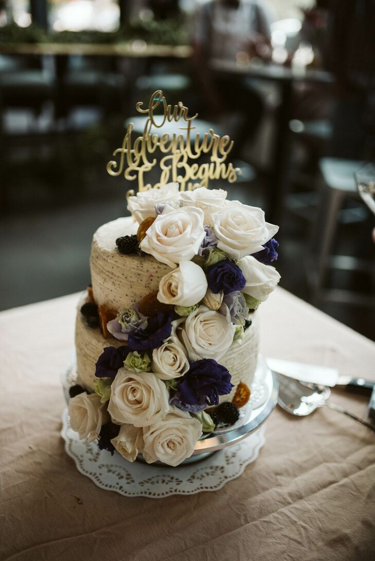 Romantic Wedding Cake with Roses and Gold Topper
