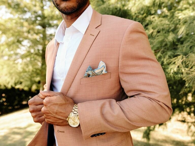 Groom wearing wedding suit and accessories
