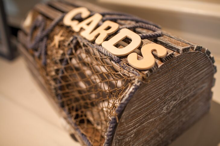 Guests placed cards for the couple in a repurposed wood lobster trap.