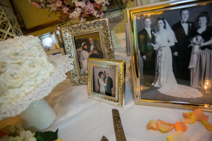 """Arranged on tables throughout the reception, wedding photos from Lindsey's and Danny's families were placed upon rose petals. """"It was a touching representation of both loved ones passed as well as the love and bonds of the past that have carried out until our wedding day,"""" Lindsey says."""