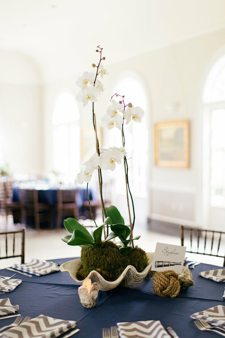 The nautical-themed tablescapes had orchids in large sea shells, knotted rope that held table cards and votives made from shells.