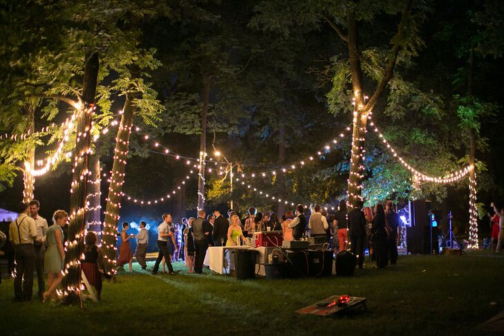 """""""The amazing lights were done by my husband and a groomsman,"""" Kate says. """"IT look them five hours to set up, but he did it just for me because he knew how much it meant to me."""""""