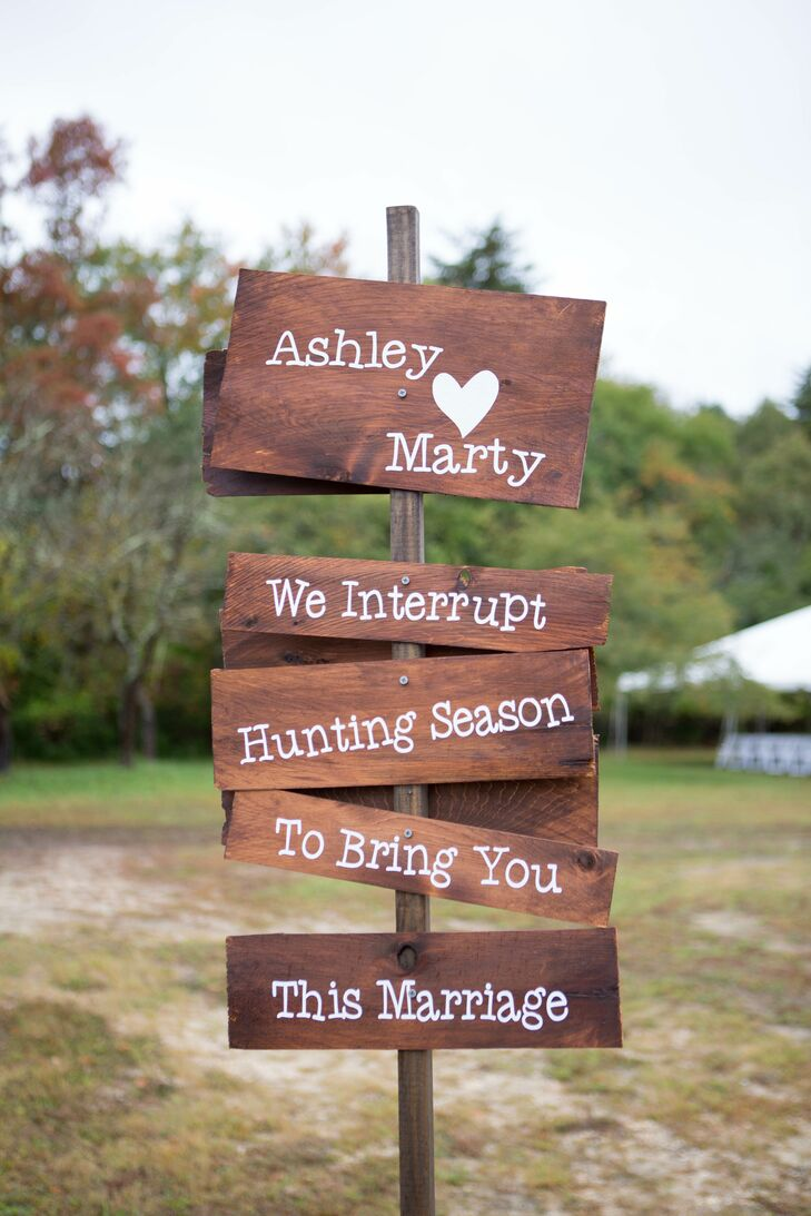 "Ashley and Marty's guests were welcomed with a cheeky wooden sign that read, ""We interrupt hunting season to bring you this marriage."""