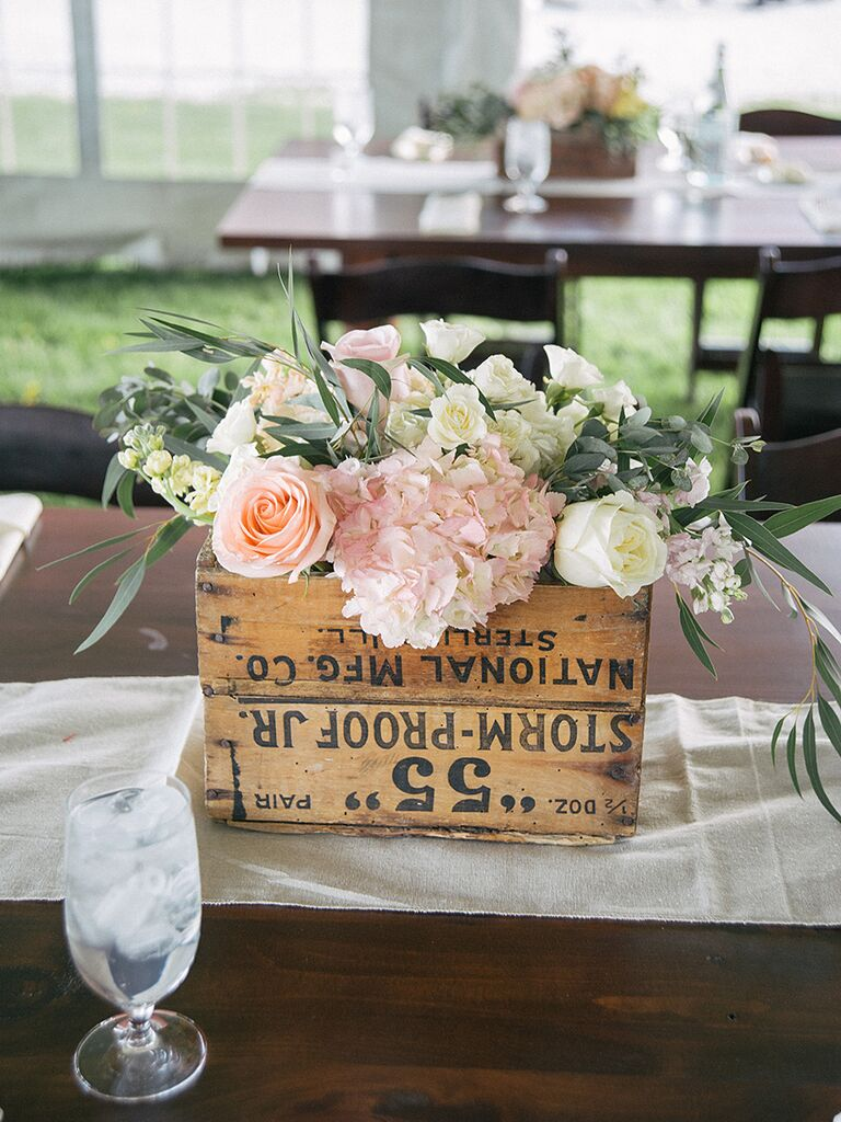 Repurposed vintage wooden crate centerpiece idea for a wedding reception centerpiece