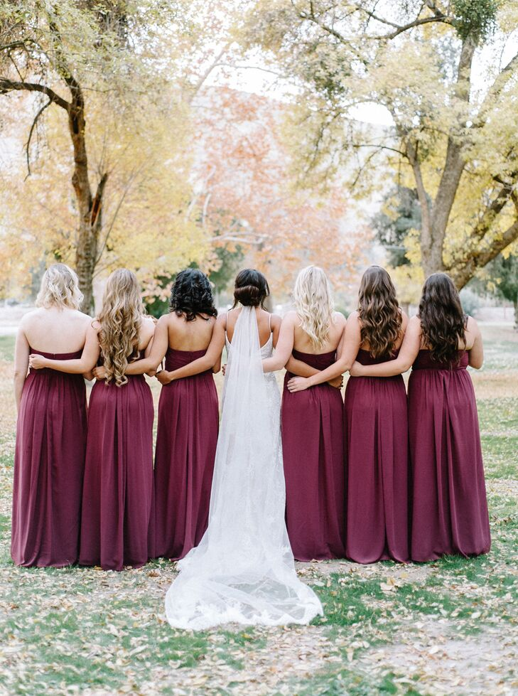 For her bridesmaids, Danika chose long, deep wine-hued gowns. The look fit well with the rustic, wintertime wedding.