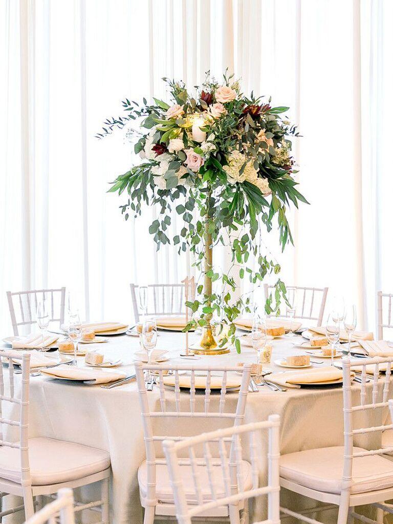 spring wedding centerpieces tall boho arrangement with eucalyptus and dark flowers