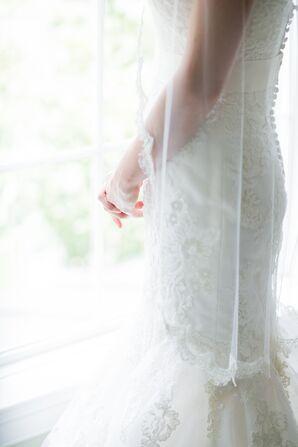 Bride In Veil Standing Near Window