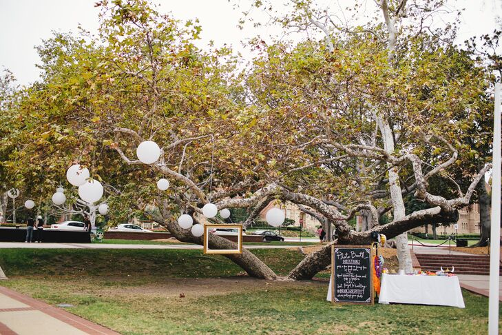 """""""We hung a large frame by fishing wire from two trees and set it up as a photo booth,"""" says the couple."""