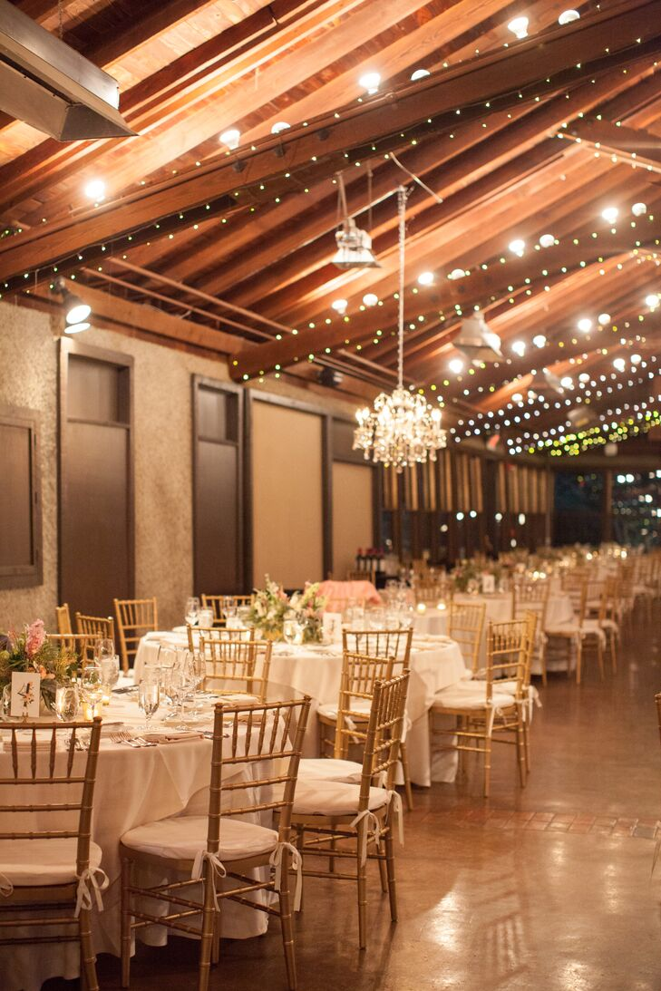 Candles, gold pumpkins and rustic wooden boxes filled with ivory and blush flowers warmed the indoor reception.