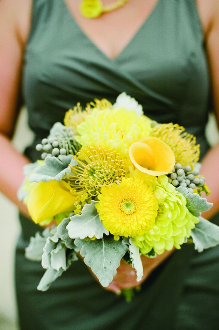 The bridesmaid bouquets were filled with yellow blooms like dahlias, calla lilies and pincushion protea and accented with dusty miller and silver brunia.