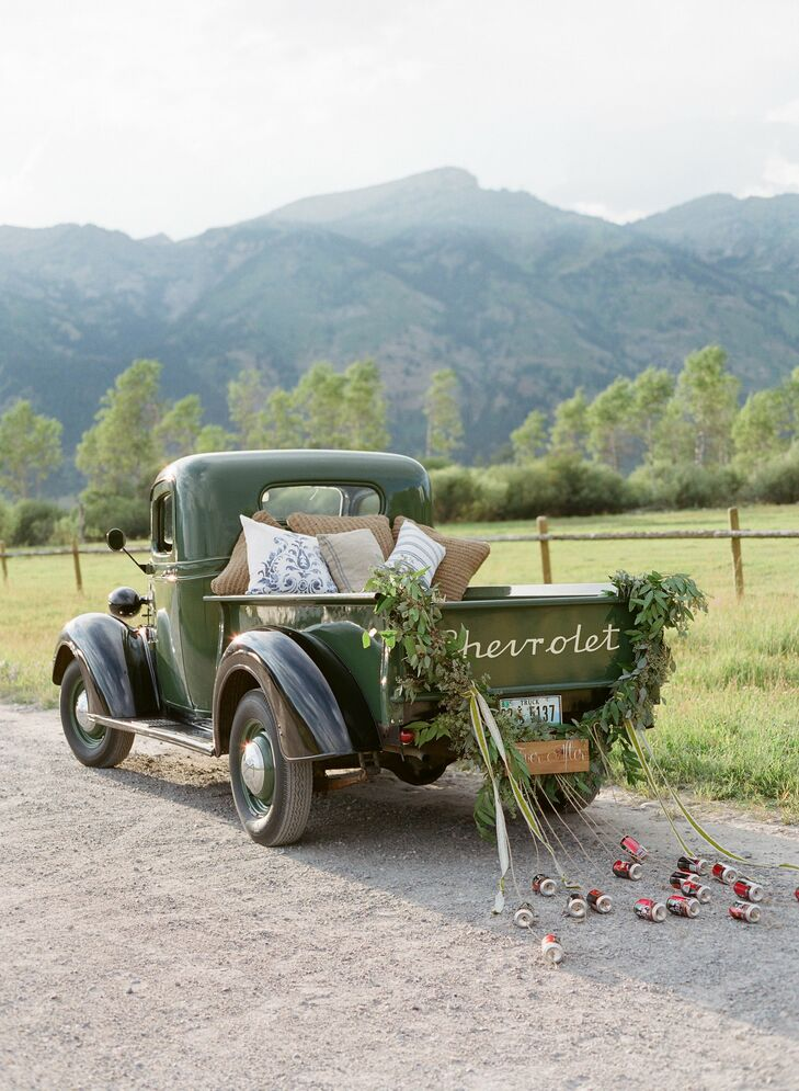 The couple made their getaway in a hunter green vintage pickup truck, which pulled empty cans of a local microbrew.